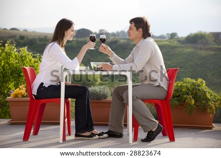happy young couple having romantic  dinner outdoors - stock photo