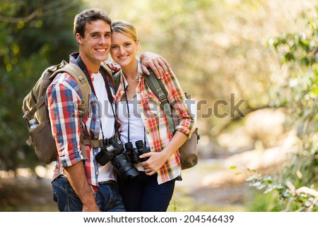 happy young couple hiking in mountain - stock photo