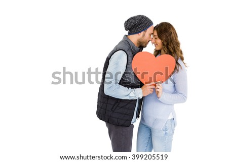 Happy young couple holding heart on white background - stock photo