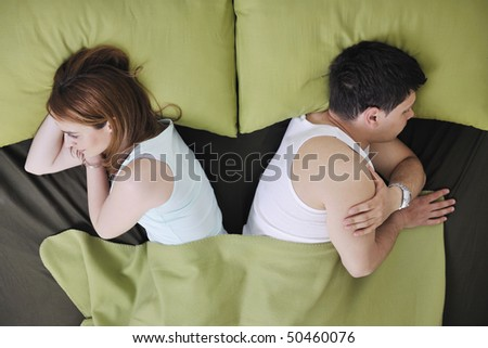 happy young couple in bed at morning - stock photo