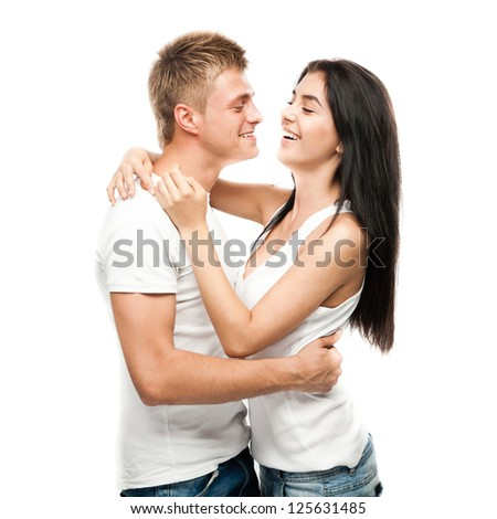Happy young couple in casual clothing isolated on white background - stock photo