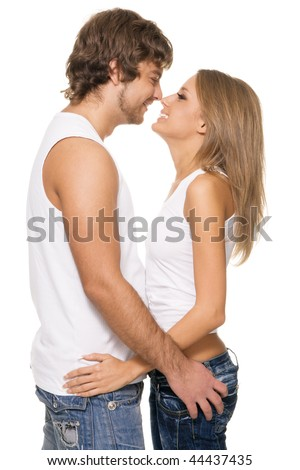 Happy young couple in casual clothing, white background