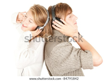 happy young couple in headphones listening music with pleasure - stock photo