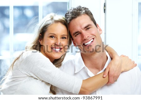 Happy young couple in love at new home. - stock photo