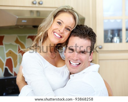 Happy young couple in love at new home.