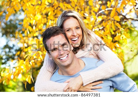 Happy young couple in love at the park. - stock photo
