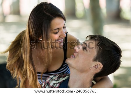 Happy young couple in love having a date in park at summer day
