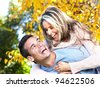 Happy young couple in love in the park. - stock photo