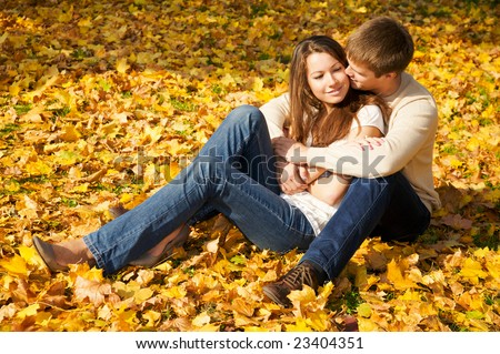 Happy young couple in love meeting in the autumn park - stock photo