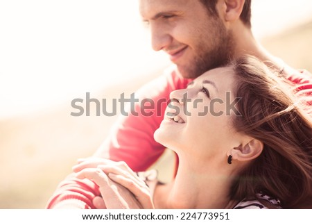 happy young couple in love on a sunny day at the beach in summer - stock photo