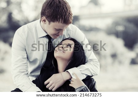 Happy young couple in love outdoor - stock photo