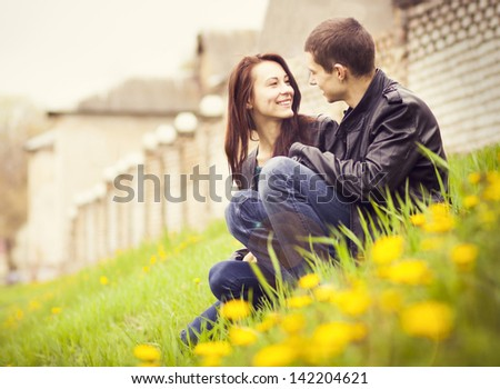 happy young couple in love outdoor in spring - stock photo
