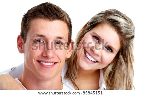 Happy young couple in love. Over white background.