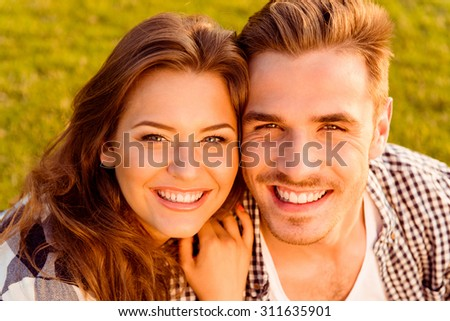 happy young couple in love smiling - stock photo