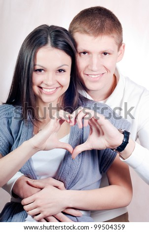 Happy young couple in love studio