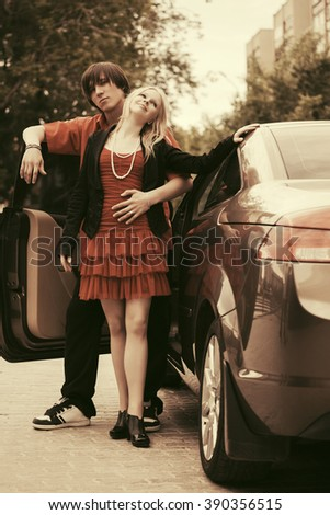 Happy young couple in love with new car - stock photo
