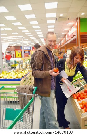 happy young couple in shopping - stock photo