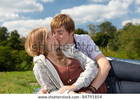 happy young couple in sunny day on the meadow - stock photo