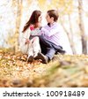 happy young couple in the autumn park - stock photo