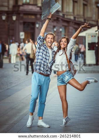Happy young couple in the city - stock photo
