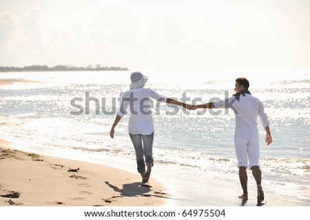 happy young couple in white clothing  have romantic recreation and   fun at beautiful beach on  vacations - stock photo