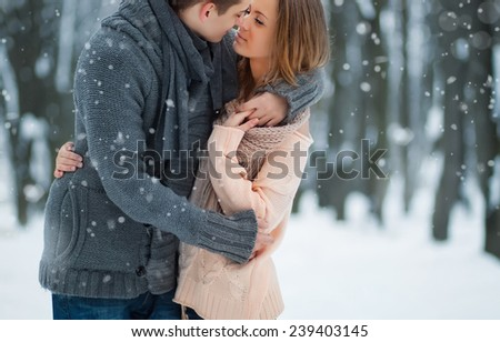 Happy Young Couple in Winter Park - stock photo
