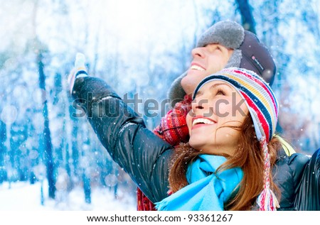 Happy Young Couple in Winter Park having fun.Family Outdoors - stock photo