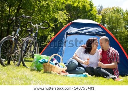 Happy young couple is relaxing on a camping
