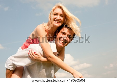 Happy young couple  jumping in sky - stock photo