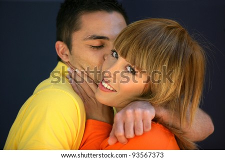 Happy young couple kissing - stock photo