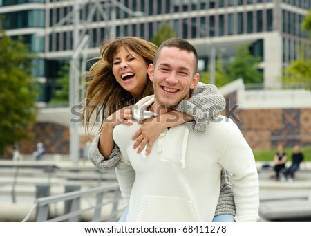 Happy young couple laughing in the city. Love Story series