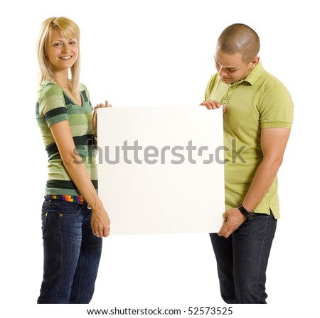 Happy young couple look at bill board over white