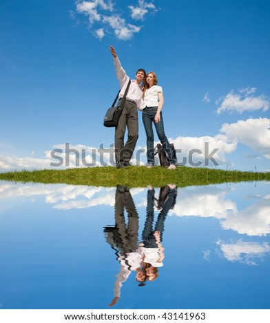 Happy young couple looking - stock photo