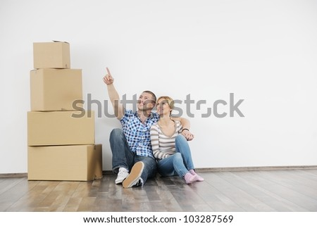 happy Young couple moving in new home - stock photo