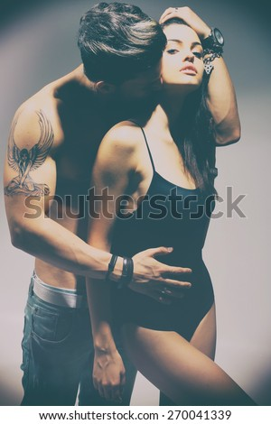 Happy young couple. No brand..Fashion colors. - stock photo