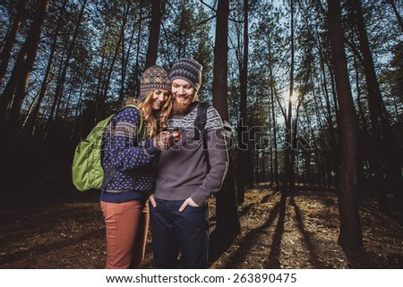 Happy young couple of tourists and taking selfie - stock photo