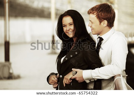Happy young couple on a city street. - stock photo