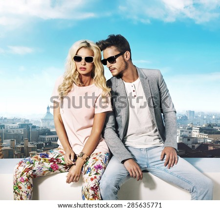 Happy young couple on a sunny vacation day - stock photo