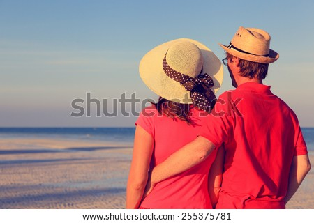Happy young couple on mexican summer beach - stock photo