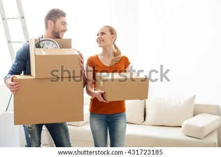 Happy young couple on their moving in day
