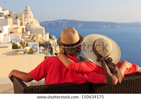 happy young couple on vacation in Santorini, Greece - stock photo