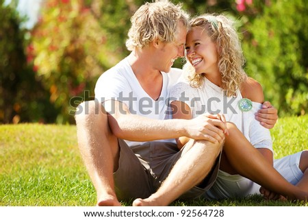 Happy young couple outdoors. - stock photo