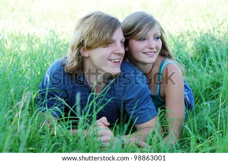 happy young couple outdoors in summer - stock photo