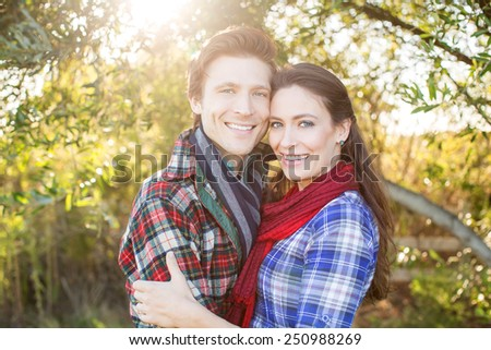 Happy young couple outside on a sunny day - stock photo