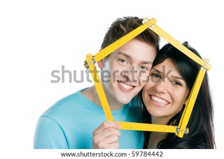 Happy young couple planning and desire their new home isolated on white background - stock photo