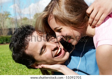 Happy young couple playing. close-up - stock photo