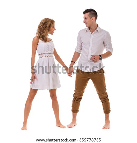 Happy young couple. Portrait of cheerful couple smiling against isolated white background in full length with copyspace - stock photo
