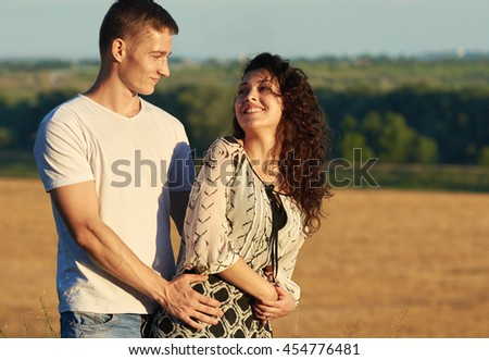happy young couple posing high on country outdoor, romantic people concept, summer season - stock photo