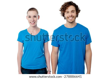 Happy young couple posing together - stock photo