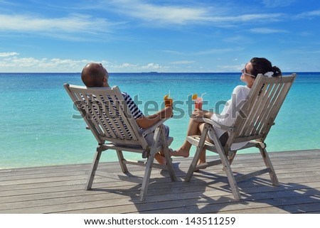 happy young couple relax and take fresh drink at summer vacation - stock photo